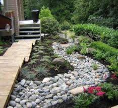 Backyard Landscaping Ideas With Rocks by Backyard With River Rock Walkway And Small Shrubs Landscaping