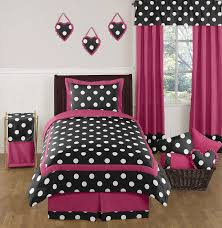pink and purple girls bedding cream curtains on the white wall with purple floral girls bedding