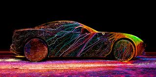 photographer coats a ferrari in an explosion of color with uv