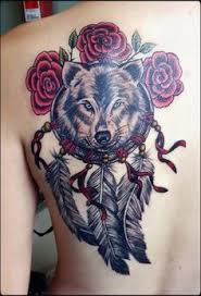 wolf in a catcher on the shoulder blade done by