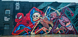 say hello to atlanta s latest batch of eye popping street murals an anatomical look at spider man in the old fourth ward by nychos find it on the west facing exterior wall of the sound table 483 edgewood ave