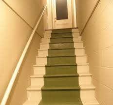 before and after of basement stairs painted with multicolored