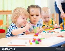 happy kids doing arts crafts day stock photo 416705404 shutterstock