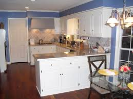 kitchen color idea appealing white plywood kitchen cabinetry set in blue wall paint