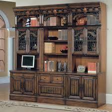 high brown wooden bookshelf with sliding glass door for shelves