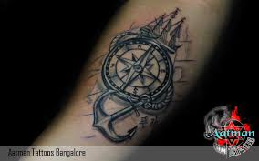 compass design tattoo in fore hand in our tattoo studio you will