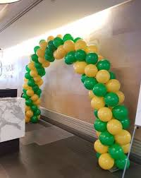 balloon delivery bronx ny aussie themed balloon arch in goldenrod and green
