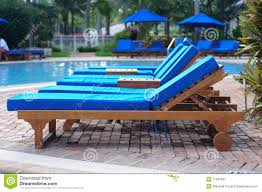 Plastic Pool Chaise Lounge Chairs Simple White Plastic Pool Chairs At The Swimming Pool Stock Photo