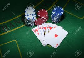 poker table top and chips cards and chips for poker on green table top view stock photo