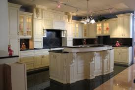 cool white painted finish country inspired kitchen cabinets