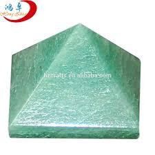 engraved golden green aventurine pyramid