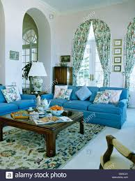 blue sofas and low wood coffee table in portuguese living room