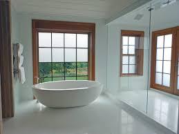 bathroom window treatments for arched windows small bathroom