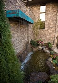 exterior design retaining wall ideas with backyard waterfall