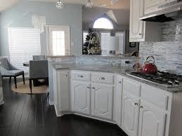 lovely red stainless steel kettle smooth gray granite backsplash