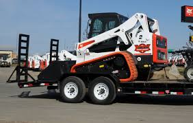 safety tips for transporting your compact loader
