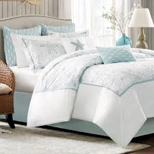 white blue bedding set with starfish placed on the blue bed having