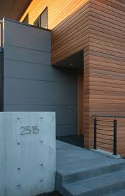 hardiplank siding cost entry modern with concrete garden wall