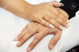 groom bride hand nails pedicure rings gold white stock photo