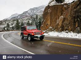 red jeep red jeep traveling on highway 550 the million dollar highway
