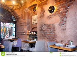 the refined interior of the small restaurant editorial image