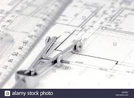 floor plan drafting architect workspace with floor plan drawing compass and ruler