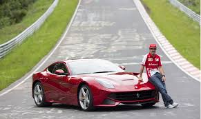 f12 berlinetta fernando alonso gives while driving a f12 on the