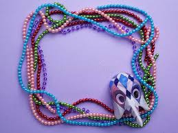 bead mask mardi gras and mask a frame with copy space on purple