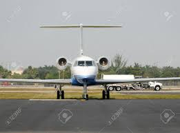 Luxury Private Jets Luxury Private Jet On The Ground Front View Stock Photo Picture