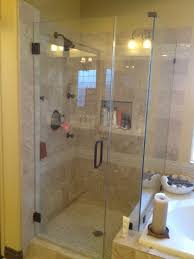 narrow bathroom with frameless glass shower door and double