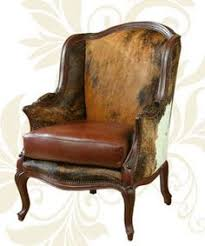 beautiful cowhide chair from hill country interiors stylish