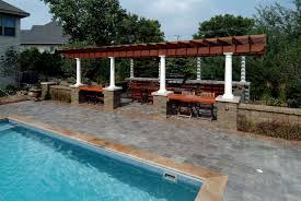 pergola outdoor kitchen cascade pool with custom tile mosaic pergola outdoor kitchen and