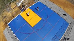 colorful backyard sport court half court basketball with