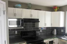 Decorative Kitchen Backsplash Tiles Modern Kitchen Appliance Set Attached On White Cabinets And Black