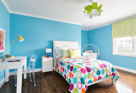 cute decor with multicolor single bed on brown parquet and blue decoration cute decor with multicolor single bed on brown parquet and blue wall close white