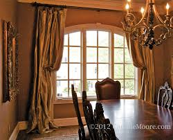 window treatments for arched windows silk draperies pulled back