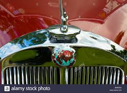 a vintage car ornament of the world on a classic triumph car