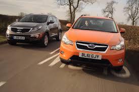 nissan qashqai vs subaru xv subaru xv vs kia sportage group tests auto express