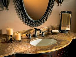 ornate black mirror and superb granite countertops with nice