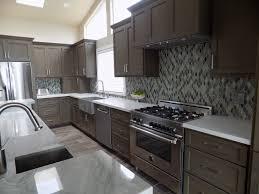 stone kitchen design sea pearl quartzite island and caesarstone fresh concrete