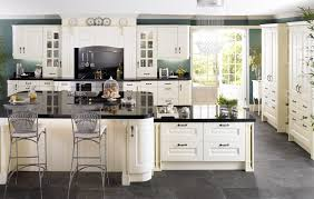white wooden kitchen island with black counter top feat gray steel