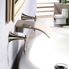 milly brass waterfall wall mounted double handles bathroom sink