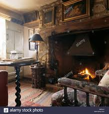 pictures on wall above inglenook fireplace in old fashioned living