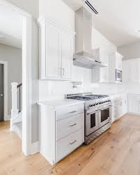 white kitchen cabinets with quartz countertops modern traditional white kitchen with custom stainless range