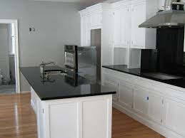 Pictures Of Kitchens With White Cabinets And Black Countertops White Cabinets Black Countertops What Color Floor Smith Design