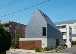 kentaro ishida adds stripy steel skin to asymmetric house in japan