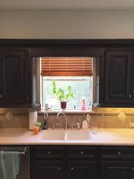 kitchen cabinets above sink take your kitchen cabinets to the ceiling designed