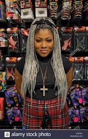 halloween city stores a young lady with long gray hair extensions at a costume store