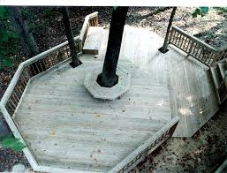multi level deck with circular bench around large existing tree