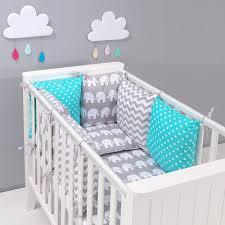 chambre bébé gris et turquoise tour de lit à coussins modulables avec parure de lit bébé eléphants
